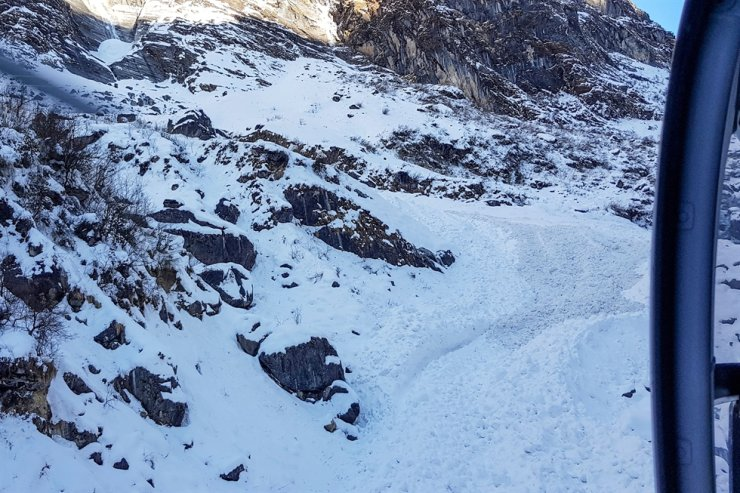 In this file photo taken on Jan. 20, 2020, a general view shows from a helicopter the avalanche site in Annapurna mountain region, some 200 kilometers west of Kathmandu. Search teams looking for the bodies of four Koreans killed in a Himalayas avalanche have found the frozen corpse of their Nepali guide, police said on April 25. AFP