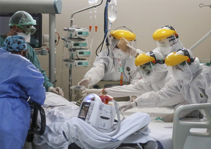 Healthcare workers tend to a patient in one of the intensive care units for COVID-19 patients at the Akdeniz University Hospital in Antalya, Turkey, in this April 22 file photo. AP