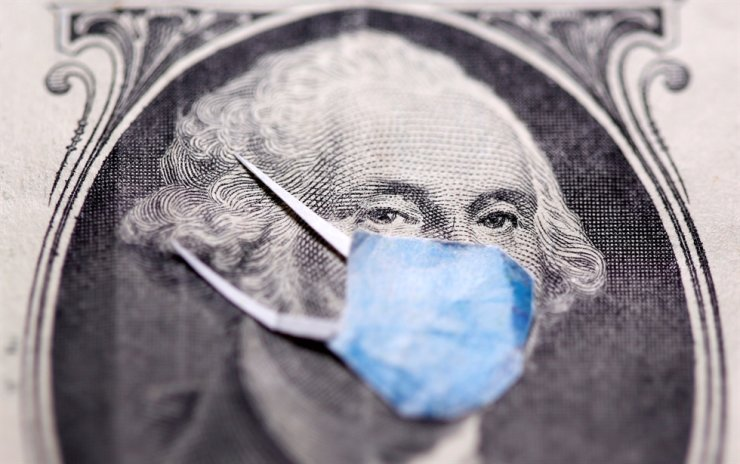 George Washington is seen with printed medical mask on the one dollar banknote in this illustration taken, March 31, 2020. Reuters