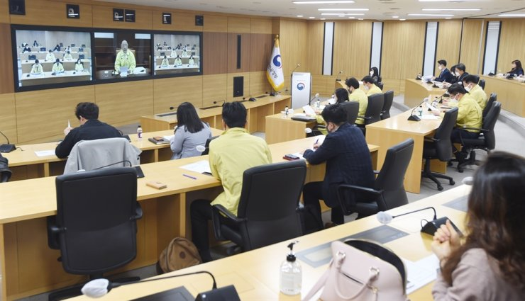 Deputy Prime Minister and Finance Minister Hong Nam-ki, center screen, speaks at a meeting attended by officials from economy-related ministries at the Gwanghwamun Government Complex in Seoul, Monday. Courtesy of Ministry of Finance