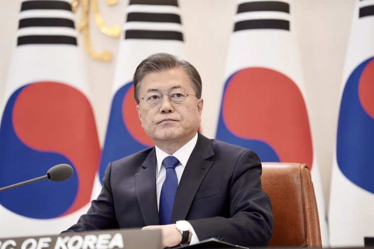 President Moon Jae-in speaks during a video conference with leaders from ASEAN members as well as China and Japan at Cheong Wa Dae, Tuesday. Yonhap