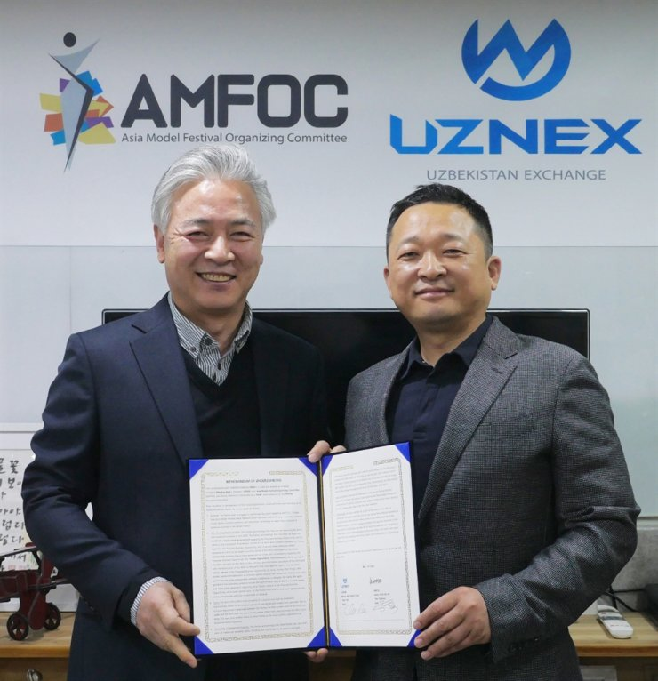 The Asia Model Festival Organizing Committee (AMFOC) and Uzbekistan cryptocurrency exchange UZNEX reached a marketing partnership agreement on Tuesday. Courtesy of AMFOC