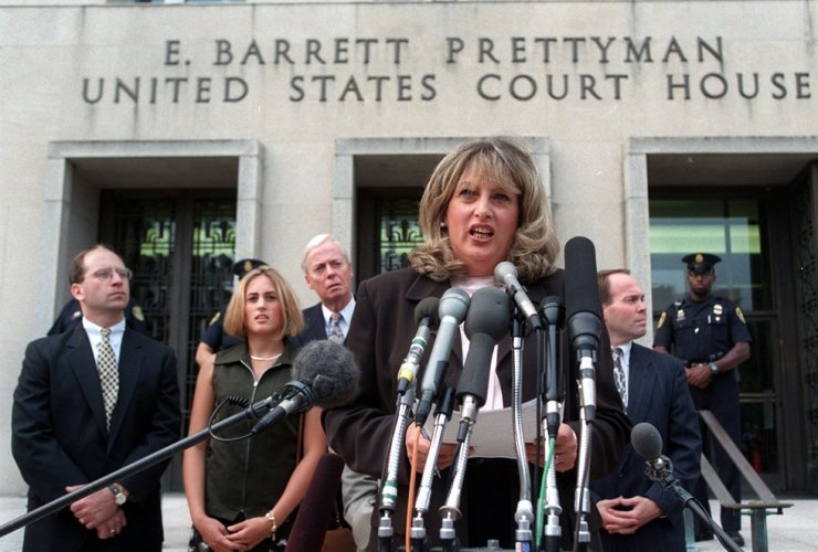 In this July 29, 1998, file photo Linda Tripp meets with reporters outside federal court in Washington after her final appearance before a grand jury investigating an alleged affair between President Bill Clinton and Monica Lewinsky. AP