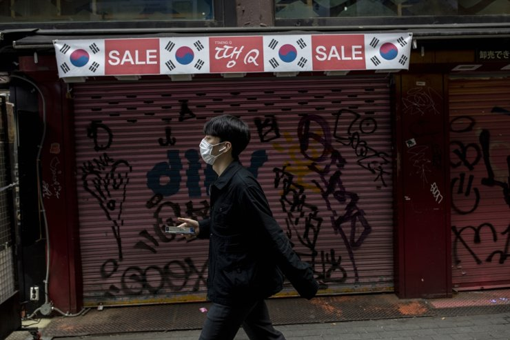 A man passes closed stores in Myeongdong, Seoul, March 17. Korea Times photo by Shim Hyun-chul