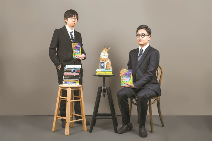 From left: sci-fi authors Jeon Sam-hye and Lee San-hwa pose with a rabbit representing union president Djuna, a pen name, in this photo provided by Science Fiction Writers Union of the Republic of Korea (SFWUK). Djuna Barnes is a postmodern authoresse who wrote 'The Rabbit' amongst many other titles. / Courtesy of SFWUK