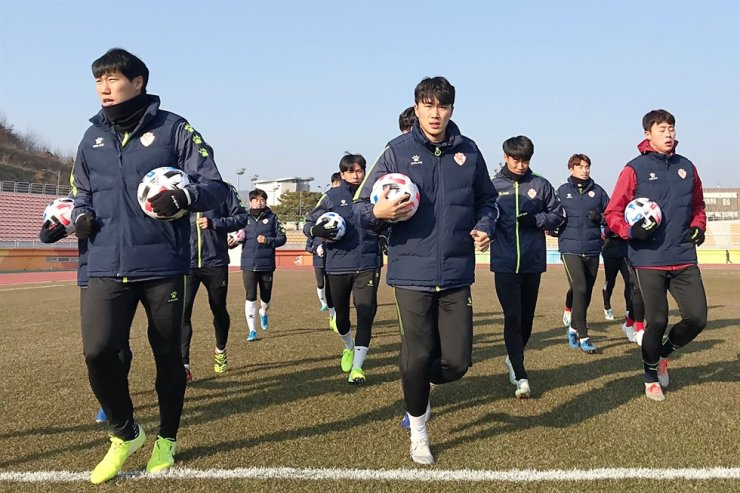 Gwangju FC players train at Suncheon Palma Stadium in Suncheon, South Jeolla Province, in January. The team was promoted to K League 1 this year. / Courtesy of Gwangju FC