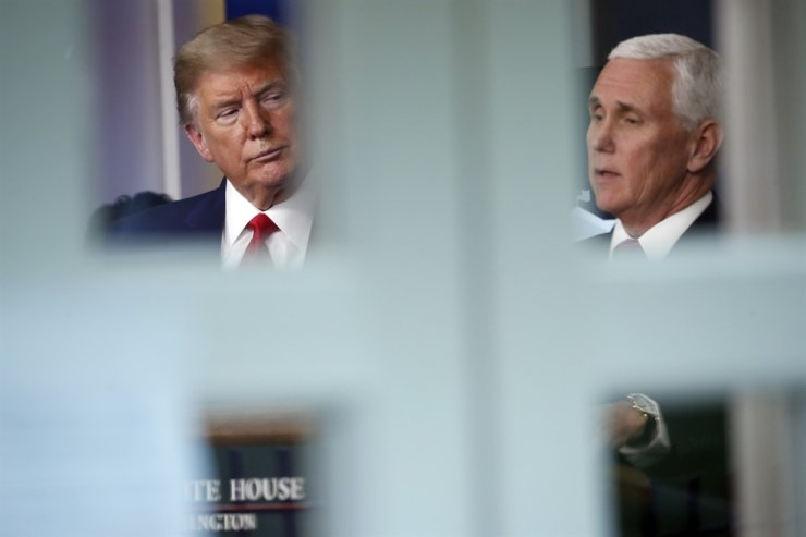U.S. President Donald Trump listens as Vice President Mike Pence speaks about the coronavirus in the James Brady Press Briefing Room at the White House in Washington, Monday, April 13. AP