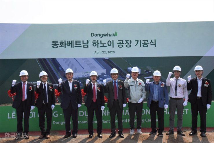 Dongwha Vietnam General Manager Kim Myung-sik, fifth from left, poses with other officials at a groundbreaking ceremony for a new production line in Hanoi, Wednesday. / Courtesy of Dongwha Enterprise