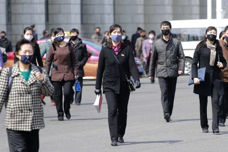 Pedestrians wear face masks to help prevent the spread of the coronavirus, Wednesday, April 1, in Pyongyang, North Korea. The new coronavirus causes mild or moderate symptoms for most people, but for some, especially older adults and people with existing health problems, it can cause more severe illness or death. AP-Yonhap