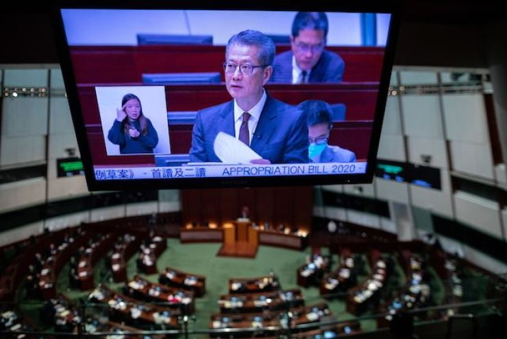 A screen shows Financial Secretary Paul Chan Mo-po delivering the budget for 2020-21 at the Legislative Council in Hong Kong on February 26. EPA