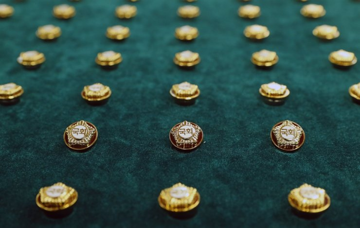 Badges for lawmakers of the 21st National Assembly are on display at the parliament building in Seoul, Monday, two days ahead of the general election that will make up the 300-seat Assembly. / Yonhap