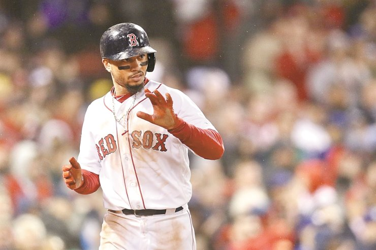 Mookie Betts of the Boston Red Sox reacts after scoring a fifth inning run against the Los Angeles Dodgers in Game One of the 2018 World Series at Fenway Park on Oct. 23, 2018 in Boston, MA. / AFP-Yonhap