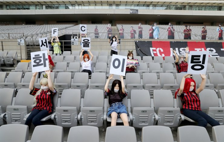 Sex dolls fill an empty football stadium in western Seoul during Seoul's game with Gwangju, Sunday. Yonhap