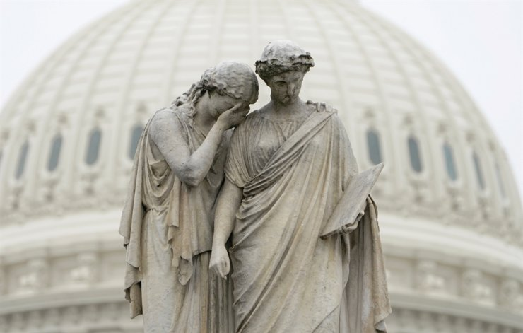 'Grief holds her covered face against the shoulder of History and weeps in mourning' as depicted at the Peace Monument in front of the U.S. Capitol in Washington, U.S. Reuters