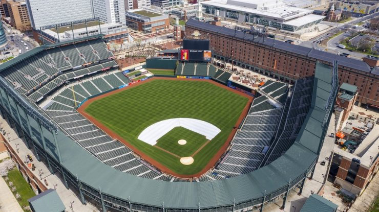 Oriole Park at Camden Yards is closed on what would've been Opening Day in Baltimore, Md., March 26. Whenever baseball returns because of the coronavirus pandemic, there's an element that might come into play like never before: the sound of silence. / AP-Yonhap