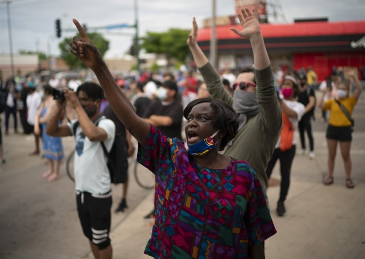 Demonstrators chant at police officers outside the Minneapolis police third Precinct in Minneapolis on Wednesday afternoon, May 27, 2020. The mayor of Minneapolis called Wednesday for criminal charges against the white police officer seen on video kneeling against the neck of Floyd George, a handcuffed black man who complained that he could not breathe and died in police custody. AP