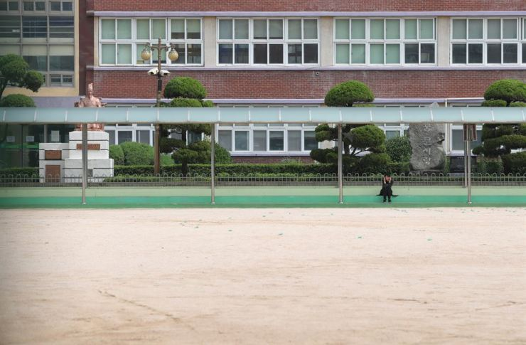A playground of an elementary school in Incheon, west of Seoul, Thursday, remains empty after the Ministry of Education suspended classes at some of the city's schools following an infection cluster at a logistics center in the nearby city of Bucheon, Gyeonggi Province. Yonhap