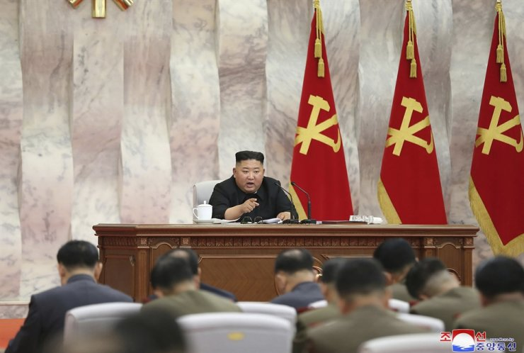 In this undated photo provided on Sunday, May 24, 2020, by the North Korean government, North Korean leader Kim Jong-un speaks during a meeting of the Seventh Central Military Commission of the Workers' Party of Korea in North Korea. AP