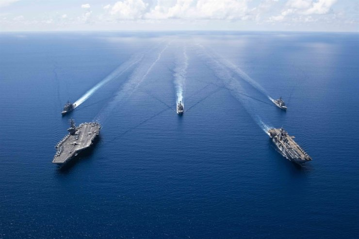 U.S. Navy ships from Ronald Reagan Carrier Strike Group and Boxer Amphibious Ready Group sailing in formation in the South China Sea in this Oct. 6, 2019, file photo. EPA
