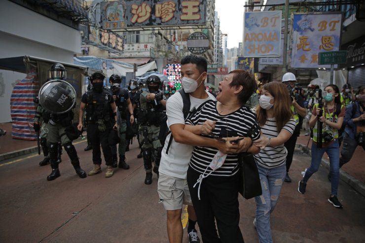 A woman argues with police as she was told to stay away from the area in Mongkok, Hong Kong, Wednesday, May 27, 2020. U.S. Secretary of State of Mike Pompeo has notified Congress that the Trump administration no longer regards Hong Kong as autonomous from mainland China. AP