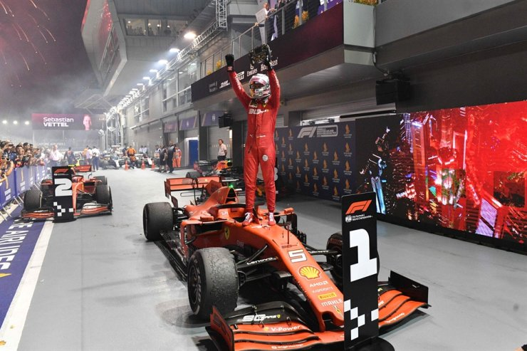 Ferrari's German driver Sebastian Vettel celebrates his victory at the end of the Formula One Singapore Grand Prix night race at the Marina Bay Street Circuit in Singapore, Sept. 22. Vettel will leave Ferrari at the end of the 2020 season. / AFP-Yonhap