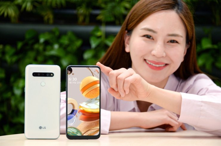 A model poses with LG Electronics' new smartphone LG Q61, which will hit local shelves on May 29. Priced at 369,600 won ($300), the handset targets budget consumers. / Courtesy of LG Electronics