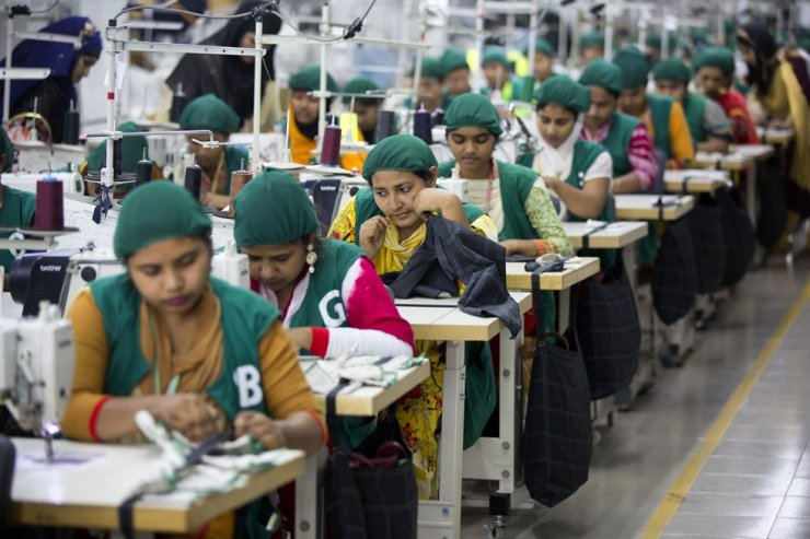 Trainees work at Snowtex garment factory in Dhamrai, near Dhaka, Bangladesh in this April 19, 2018 file photo. The livelihoods of millions of Asian garment workers are in jeopardy after cancellations by top fashion brands, with unions, researchers and campaigners warning coronavirus could lead to a rollback of labor rights in an industry often accused of abuse. /AP