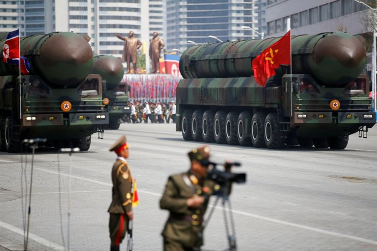 Intercontinental ballistic missiles are driven past the stand with North Korean leader Kim Jong-un and other high ranking officials during a military parade marking the 105th birth anniversary of country's founding father Kim Il-sung in Pyongyang, April 15, 2017. Reuters
