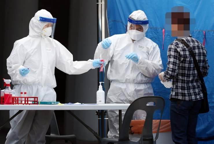 South Korea's new virus cases spiked by the most in nearly two months on Wednesday as the country grapples with a steady rise in club-linked transmission and yet another cluster infection looms. Yonhap