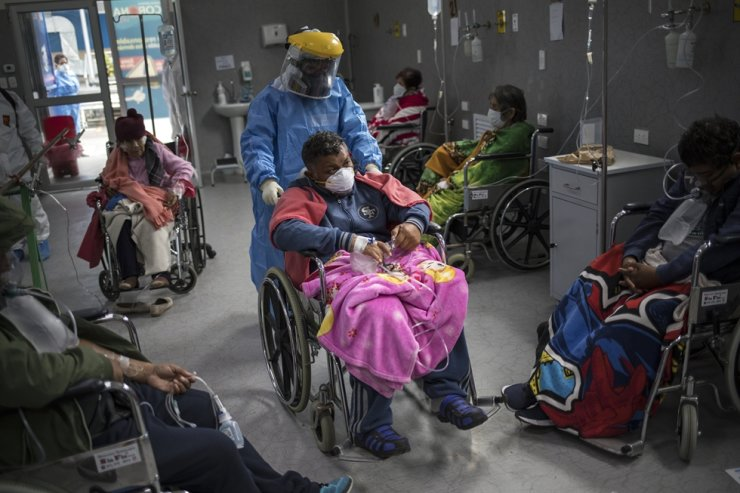 A doctor pushes a COVID-19 patient in a wheelchair in the emergency area of the Guillermo Almenara hospital in Lima, Peru, Friday, May 22, 2020. Despite strict measures to control the virus, this South American nation of 32 million has become one of the countries worst hit by the disease. AP