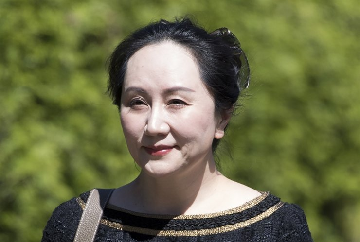 Meng Wanzhou, chief financial officer of Huawei, leaves her home to go to B.C. Supreme Court in Vancouver, British Columbia, Wednesday, May 27, 2020. The Canadian Press via AP
