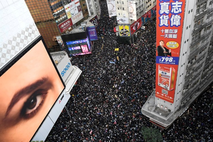 In this Dec. 8, 2019, file photo, protesters attend a Human Rights Day march in the district of Causeway Bay in Hong Kong. Reuters