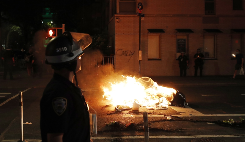 A New York City Police Department vehicle burns after being set alight by protesters as they demostrate about the arrest of George Floyd, who later died in police custody, in Brooklyn, New York, U.S., May 30, 2020. EPA