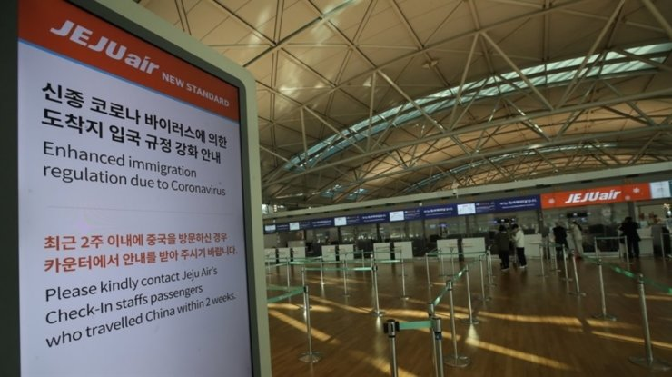 Seen above is an empty check-in counter for Jeju Air, the nation's biggest low-cost carrier, at Incheon International Airport, Feb. 5, when the spread of the COVID 19 pandemic started to raise fears in Asia. Yonhap