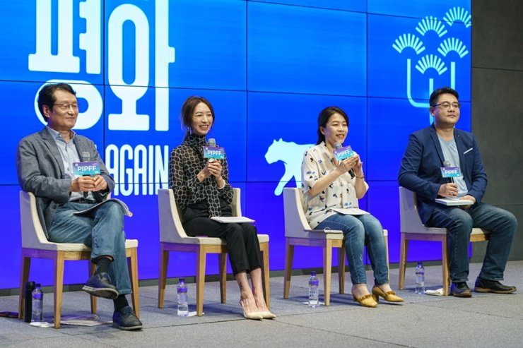 From left, film festival chairman Moon Sung-keun, director Pang Eun-jin and programmers Choi Eun-young and Kim Hyung-seok pose for a photo during a press conference for the second PyeongChang International Peace Film Festival held in Seoul, Tuesday. / Courtesy of PIPFF