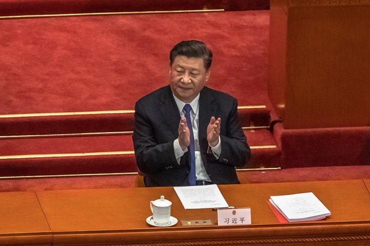 Chinese President Xi Jinping applauds after voting on the draft resolution for the controversial national security law for Hong Kong during the closing ceremony of the third session of the 13th National People's Congress at the Great Hall of the People in Beijing, May 28, 2020. EPA