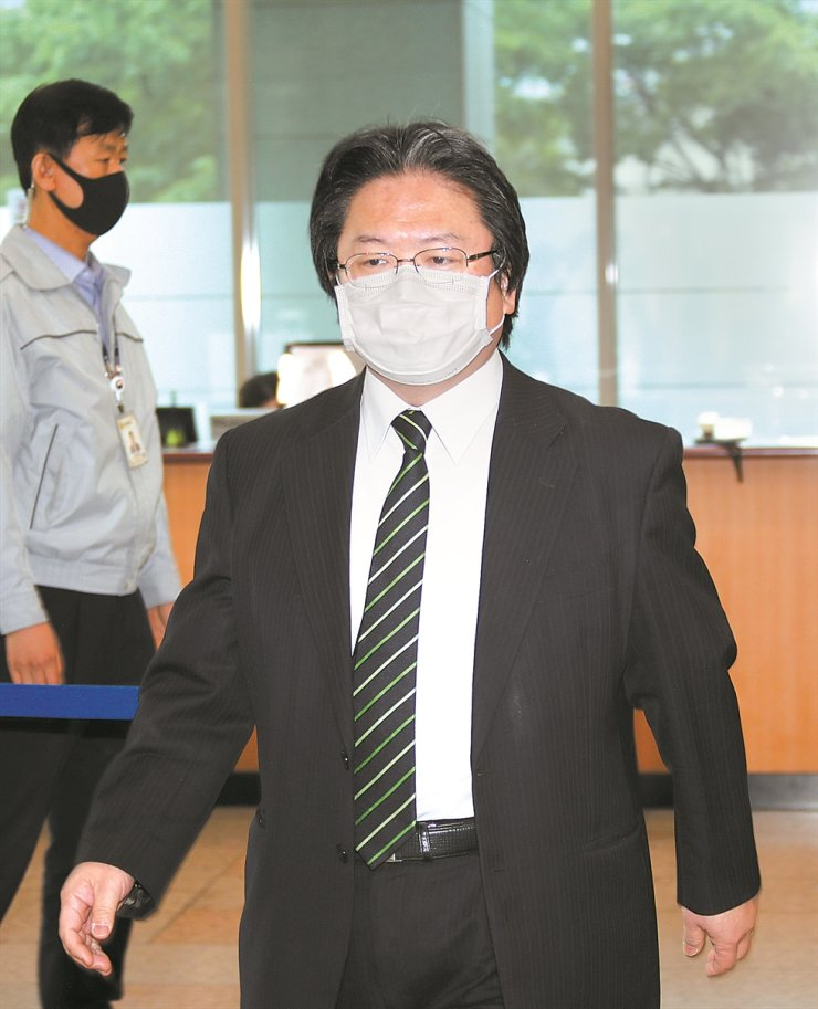 Hirohisa Soma, a senior official from the Japanese Embassy in Seoul, arrives at the Ministry of Foreign Affairs, Tuesday, upon being summoned by the Korean government over Japan's claim in its latest annual diplomatic book that Korea's easternmost islets of Dokdo are Japanese territory. The government expressed its regret over Tokyo's repeated territorial claims over Dokdo, also known as Takeshima and Liancourt Rocks. Yonhap