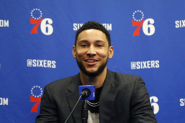 Philadelphia 76ers' Ben Simmons smiles while speaking at a news conference before an NBA basketball game against the Detroit Pistons in Philadelphia, March 11. The All-Star guard is closer to getting cleared to play, should the NBA season resume. Simmons, the league leader in steals, was sidelined with nerve issues in his lower back when the season suspended was March 11 because of the coronavirus pandemic. 'We've took our time, we've been methodical and thoughtful about his recovery and rehab, just to make sure, because we weren't in a rush,' 76ers GM Elton Brand said on Tuesday. / AP-Yonhap
