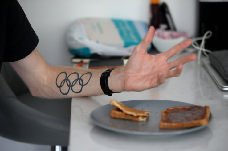 A tattoo of the Olympic rings is seen on the arm of Team GB Race Walker Tom Bosworth at his home before a training session following the outbreak of the coronavirus disease (COVID-19), Liverpool, Britain, May 19, 2020. REUTERS/Carl Recine
