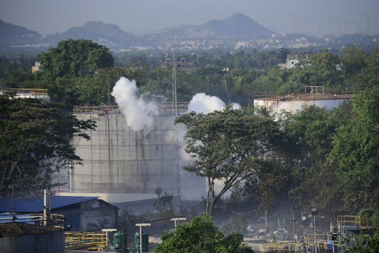 In this May 7, 2020, file photo, smoke rises from LG Polymers plant, the site of a chemical gas leakage, in Vishakhapatnam, India. The plastics factory in India where a chemical gas leak killed 12 people and sickened hundreds more last week lacked federal environmental clearance but had been issued state permits to operate anyway, exposing a potentially dangerous enforcement gap in the country's laws. AP