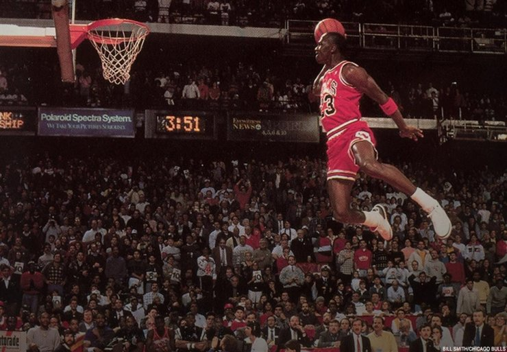 Michael Jordan connects his iconic freethrow-line dunk during slam dunk contest at the United Center in Chicago, 1988. / Korea Times file photo