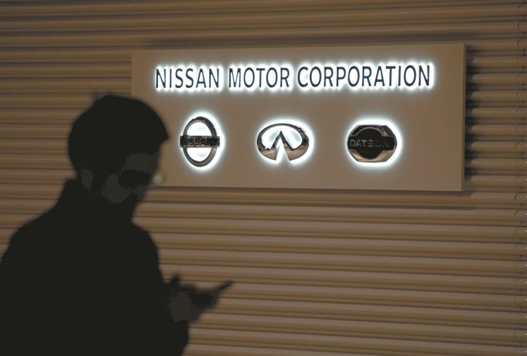 The logos of Nissan Motor are seen at the automaker's global headquarter in Yokohama, Japan, Nov. 19, 2018. / AP-Yonhap