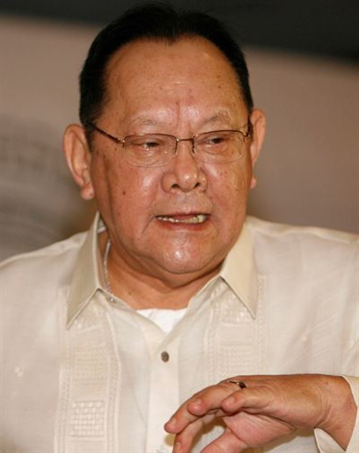 San Miguel Corporation Chairman Eduardo Cojuangco talks to the media after an annual stockholders meeting in Manila July 24, 2007. Reuters
