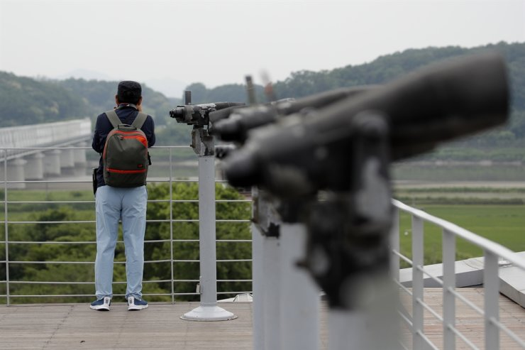 A visitor watches the northern side from the Imjingak Pavilion in Paju, Thursday, June 18, 2020. AP