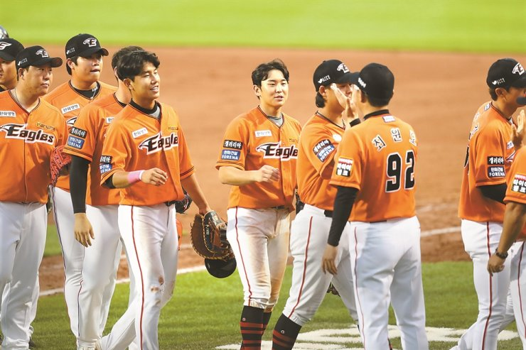 Hanwha Eagles players celebrate after the team beat Doosan Bears 3-2 during the Korea Baseball Organization game at the Eagles Park in Daejeon, Sunday. / Yonhap