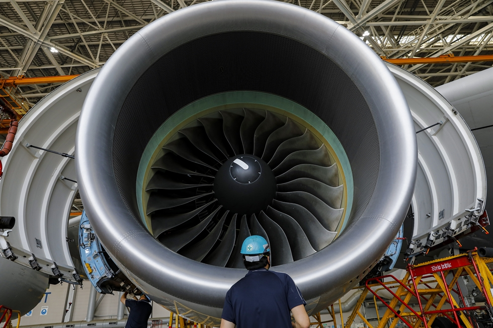 Aircraft mechanics inspect an engine of an A380 passenger jet at Korean Air's hangar in Eunseo-dong, Incheon, west of Seoul, Thursday. The airline said nearly 30 percent of its aircraft were grounded due to pandemic-driven border closures and sharp fall in passengers, but the company performs checkups on all planes as planned to keep them in good shape. Korea Times photo by Shim Hyun-chul