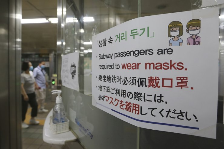 A notice on precautions against the new coronavirus is displayed at a subway station in Korea, Monday, June 22, 2020. AP