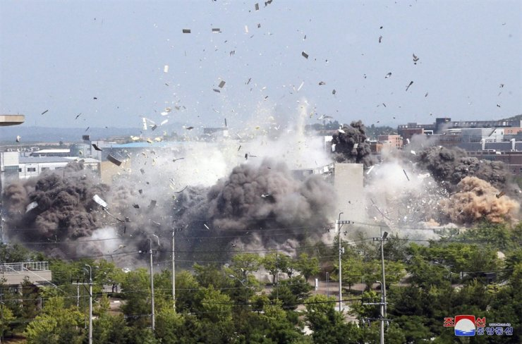 This photo provided by the North Korean government shows the demolition of an inter-Korean liaison office building in Kaesong, North Korea, Tuesday, June 16, 2020. AP