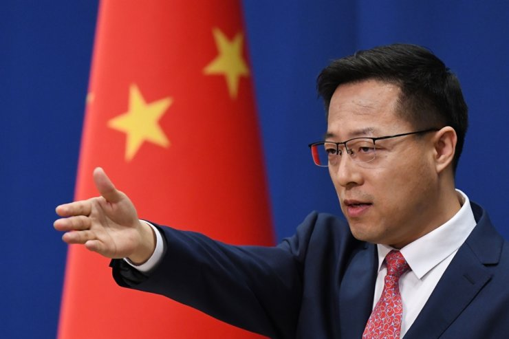 In this file photo Chinese Foreign Ministry spokesman Zhao Lijian takes a question at the daily media briefing in Beijing on April 8, 2020. AFP