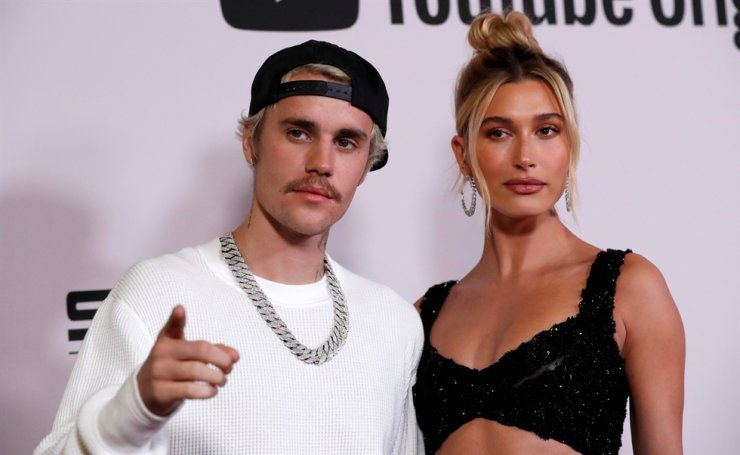 Singer Justin Bieber and his wife Hailey Baldwin pose at the premiere for the documentary television series 'Justin Bieber: Seasons' in Los Angeles, Calif., U.S., Jan. 27, 2020. Reuters